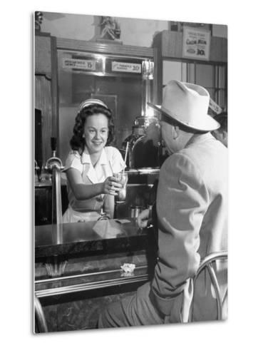 William O. Douglas's Daughter Serving Him a Soda at the Drugstore--Metal Print