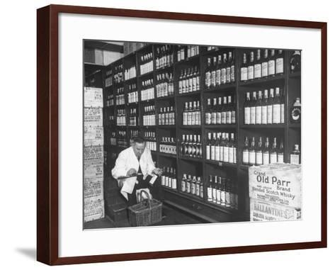 Steward at the Waldorf Astoria Hotel Working in Room Containing Wine and Spirits--Framed Art Print