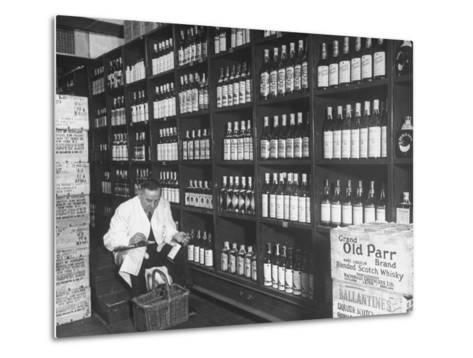 Steward at the Waldorf Astoria Hotel Working in Room Containing Wine and Spirits--Metal Print