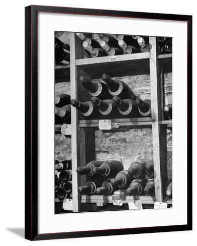 Dust Covered French Vintage Champagnes Lying on Racks in the Wine Cellar--Framed Art Print