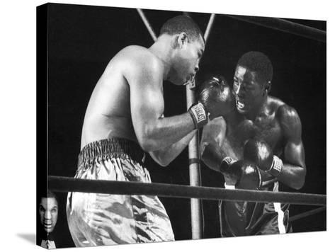 Boxers Joe Louis and Ezzard Charles Battling During a Bout--Stretched Canvas Print
