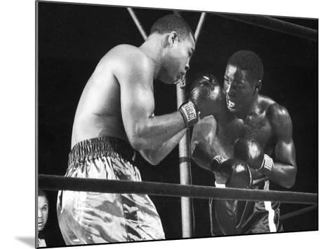 Boxers Joe Louis and Ezzard Charles Battling During a Bout--Mounted Photographic Print