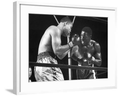 Boxers Joe Louis and Ezzard Charles Battling During a Bout--Framed Art Print