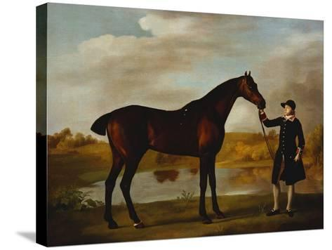 The Duke of Marlborough's (?) Bay Hunter, with a Groom in Livery in a Lake Landscape-George Stubbs-Stretched Canvas Print