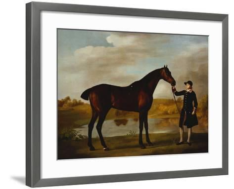 The Duke of Marlborough's (?) Bay Hunter, with a Groom in Livery in a Lake Landscape-George Stubbs-Framed Art Print