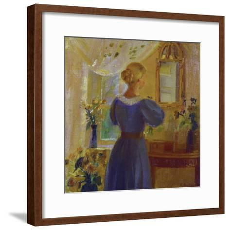 An Interior with a Woman Looking in a Mirror-Anna Kirstine Ancher-Framed Art Print
