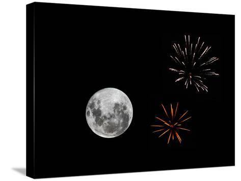 A Composite Image with Fireworks and a New Moon-Stocktrek Images-Stretched Canvas Print
