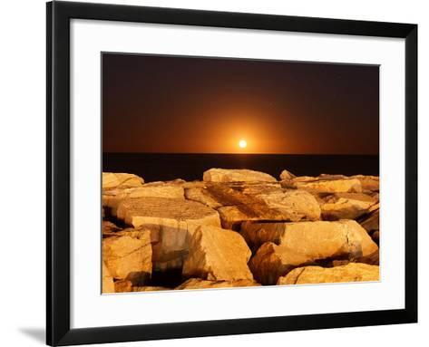 The Moon Rising Behind Rocks Lit by a Nearby Fire in Miramar, Argentina-Stocktrek Images-Framed Art Print