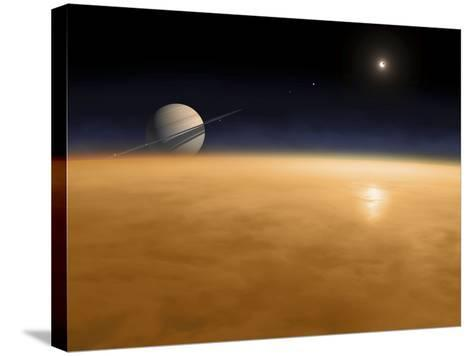Saturn Above the Thick Atmosphere of its Moon Titan-Stocktrek Images-Stretched Canvas Print