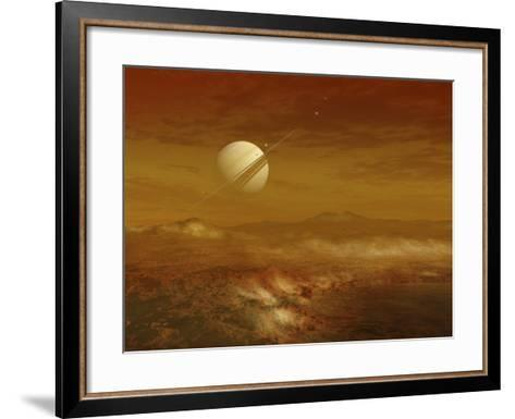 Saturn Above the Thick Atmosphere of its Moon Titan-Stocktrek Images-Framed Art Print