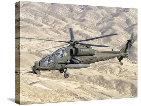 An Italian Army AW-129 Mangusta over Afghanistan-Stocktrek Images-Stretched Canvas Print