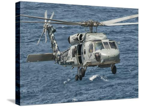 A US Navy SH-60F Seahawk Flying Off the Coast of Pakistan-Stocktrek Images-Stretched Canvas Print