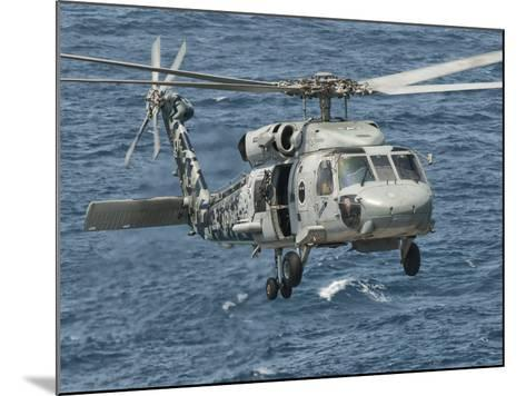 A US Navy SH-60F Seahawk Flying Off the Coast of Pakistan-Stocktrek Images-Mounted Photographic Print