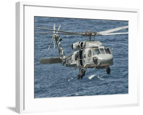 A US Navy SH-60F Seahawk Flying Off the Coast of Pakistan-Stocktrek Images-Framed Art Print