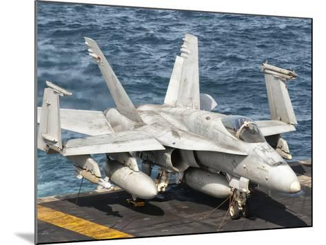 A US Navy F/A-18C Hornet Tied on the Flight Deck of USS Nimitz-Stocktrek Images-Mounted Photographic Print