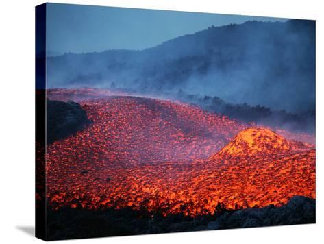 Boulder Rolling in Lava Flow at Dusk During Eruption of Mount Etna Volcano, Sicily, Italy-Stocktrek Images-Stretched Canvas Print