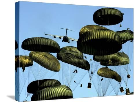 A U.S. Air Force C-17 Globemaster III Airdrops Pallets to Port-Au-Prince, Haiti-Stocktrek Images-Stretched Canvas Print