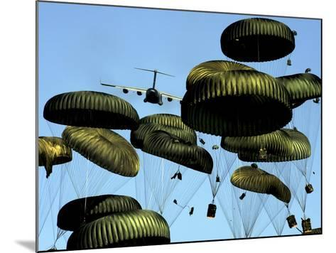A U.S. Air Force C-17 Globemaster III Airdrops Pallets to Port-Au-Prince, Haiti-Stocktrek Images-Mounted Photographic Print