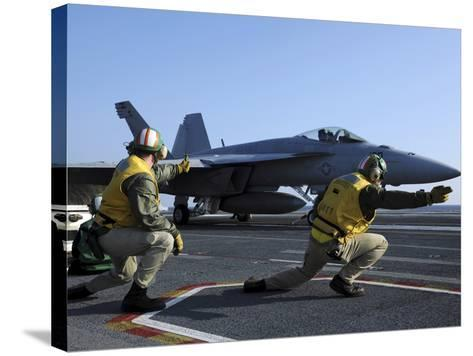 Shooters Aboard the USS George H.W. Bush Give the Go-Ahead Signal to Launch an F/A-18 Super Hornet-Stocktrek Images-Stretched Canvas Print