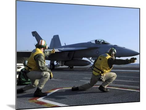 Shooters Aboard the USS George H.W. Bush Give the Go-Ahead Signal to Launch an F/A-18 Super Hornet-Stocktrek Images-Mounted Photographic Print