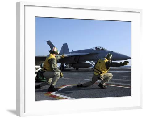 Shooters Aboard the USS George H.W. Bush Give the Go-Ahead Signal to Launch an F/A-18 Super Hornet-Stocktrek Images-Framed Art Print