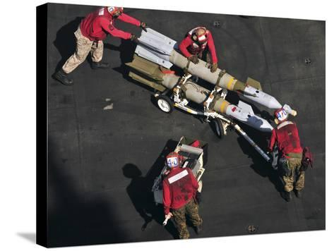 Marines Push Pordnance into Place on the Flight Deck of USS Enterprise-Stocktrek Images-Stretched Canvas Print