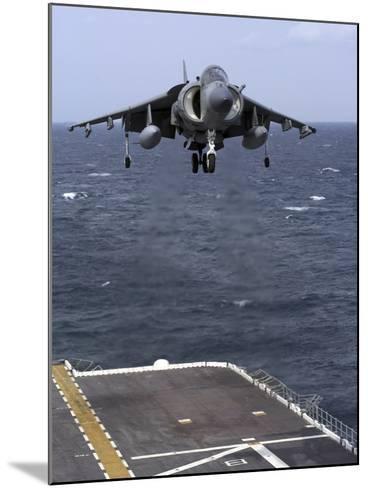 An AV-8B Harrier II Prepares to Land on the Flight Deck of USS Nassau-Stocktrek Images-Mounted Photographic Print