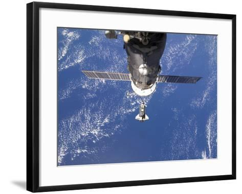 Space Shuttle Discovery Approaches the International Space Station-Stocktrek Images-Framed Art Print