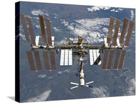 International Space Station Backgropped by a Blue and White Earth-Stocktrek Images-Stretched Canvas Print