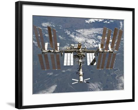 International Space Station Backgropped by a Blue and White Earth-Stocktrek Images-Framed Art Print