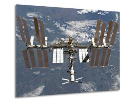 International Space Station Backgropped by a Blue and White Earth-Stocktrek Images-Metal Print