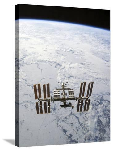 The International Space Station in Orbit Above Earth-Stocktrek Images-Stretched Canvas Print