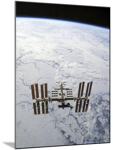 The International Space Station in Orbit Above Earth-Stocktrek Images-Mounted Photographic Print