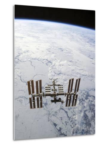 The International Space Station in Orbit Above Earth-Stocktrek Images-Metal Print