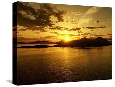 A Gas Giant and Multiple Moons Look Down on a Beautiful Island Sunset-Stocktrek Images-Stretched Canvas Print