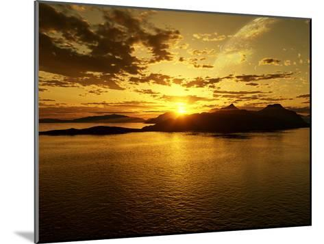 A Gas Giant and Multiple Moons Look Down on a Beautiful Island Sunset-Stocktrek Images-Mounted Photographic Print