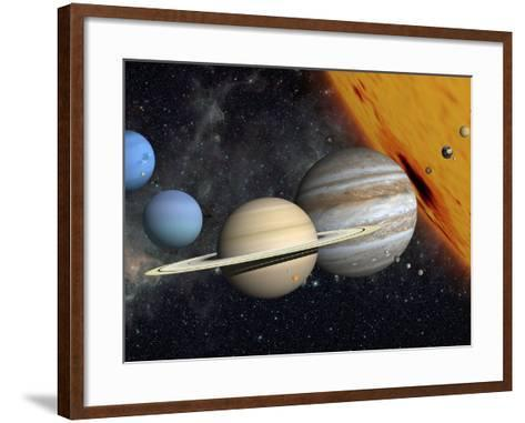 The Planets and Larger Moons to Scale with the Sun-Stocktrek Images-Framed Art Print
