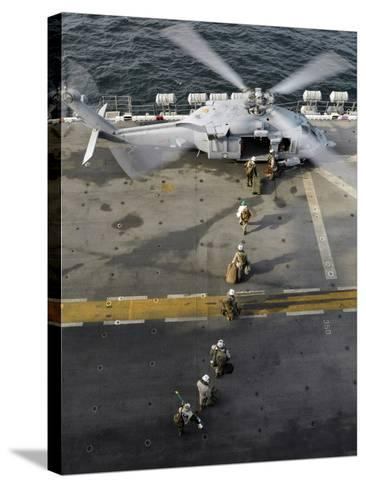 Marines Prepare to Board an MH-60S Sea Hawk Helicopter Aboard USS Peleliu-Stocktrek Images-Stretched Canvas Print