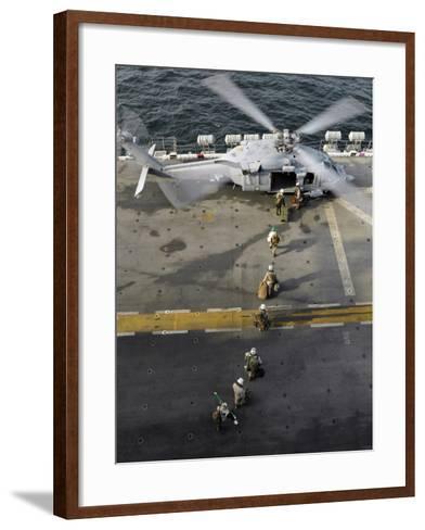 Marines Prepare to Board an MH-60S Sea Hawk Helicopter Aboard USS Peleliu-Stocktrek Images-Framed Art Print