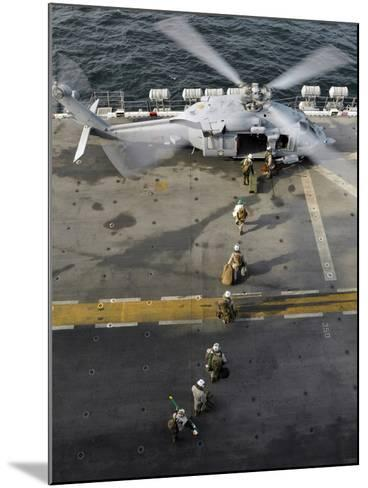 Marines Prepare to Board an MH-60S Sea Hawk Helicopter Aboard USS Peleliu-Stocktrek Images-Mounted Photographic Print