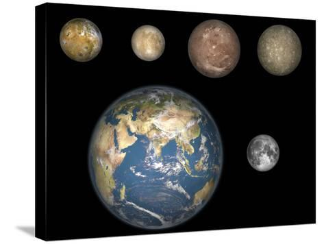 Artist's Concept of Jupiter's Four Largest Satellites Laid Out Above the Earth and it's Moon-Stocktrek Images-Stretched Canvas Print