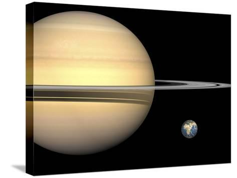 Illustration of Saturn and Earth to Scale-Stocktrek Images-Stretched Canvas Print