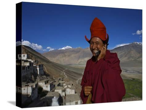 The Head Abbot Holds a Cell Phone at the Karsha Monastery-Steve Winter-Stretched Canvas Print
