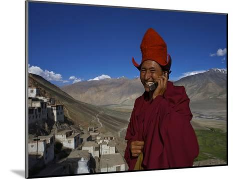 The Head Abbot Holds a Cell Phone at the Karsha Monastery-Steve Winter-Mounted Photographic Print