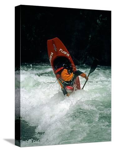 A Kayaker Paddles in Waves on the Kananskis River, Near Calgary-Gordon Wiltsie-Stretched Canvas Print