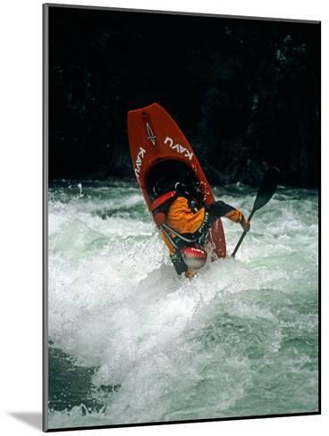 A Kayaker Paddles in Waves on the Kananskis River, Near Calgary-Gordon Wiltsie-Mounted Photographic Print