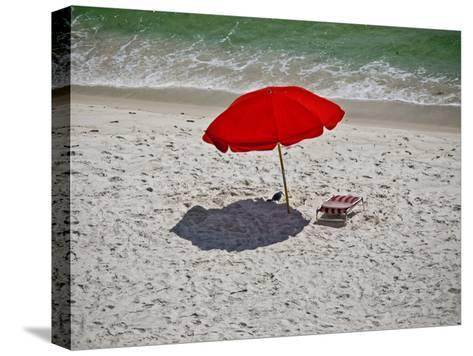 A Red Umbrella on the Beach at Gulf Shores, Alabama-National Geographic Photographer-Stretched Canvas Print