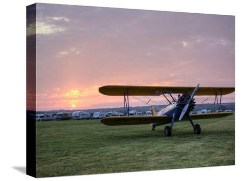 A Stearman Biplane on a Grass Airfield at Dawn-Pete Ryan-Stretched Canvas Print