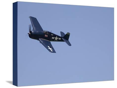 A Blue Grumman F6F-5 Hellcat Fighter Aircraft Flies Solo-Pete Ryan-Stretched Canvas Print