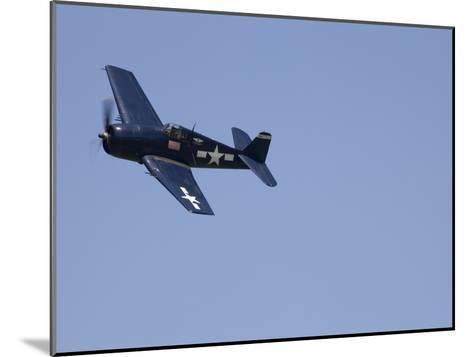 A Blue Grumman F6F-5 Hellcat Fighter Aircraft Flies Solo-Pete Ryan-Mounted Photographic Print